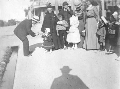 Street scene with members of the Chegwidden and Knapp families