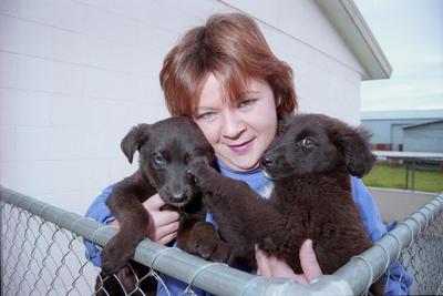 Keri Potaka with two puppies
