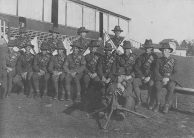 Arthur Lambert with uniformed men