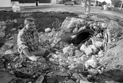 Tuck Contractors excavator driver Paul Atkins lowering Greenmeadows' Avenue Road