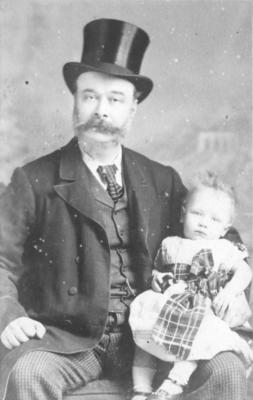 Portrait of Warwick Gumbley and an unidentified child