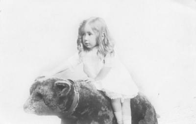 Portrait of a girl seated a toy bear